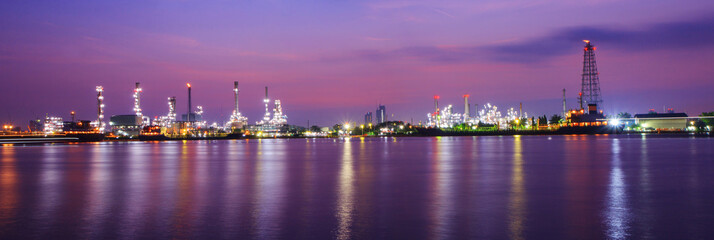 Panorama Oil refinery at the river in sunrise time / Big Factory in sunrise time