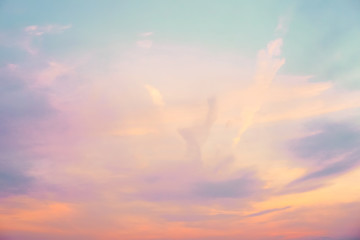 pastel colored cloudy sky - orange, purple, blue, and white
