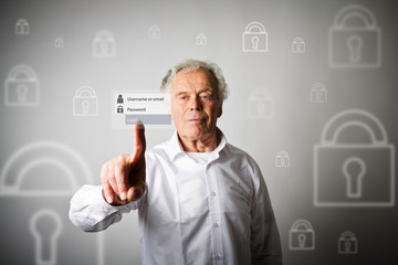 Old man is pushing the virtual button. Login and password concept.