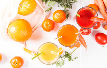 Mix juices, carrot, orange, apple and tomato drinks.
