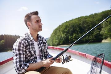 Printed kitchen splashbacks Fishing Serious men fishing in concentration