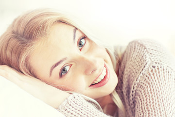 Fototapete - young woman or teen girl lying on pillow at home