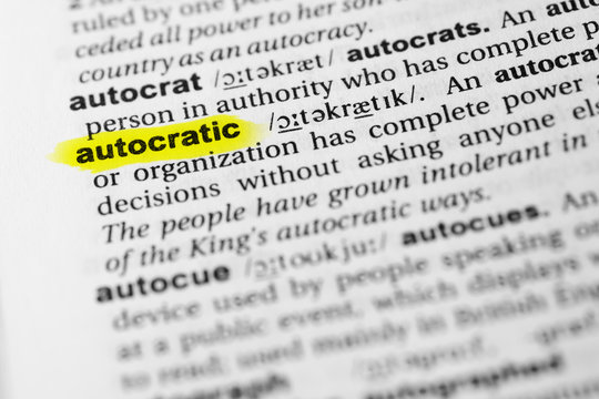 "Highlighted English word ""autocratic"" and its definition in the dictionary"