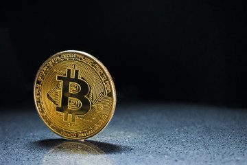 Golden Bitcoin On dark Background. Trading Concept Of Crypto Currency coin. Copy space