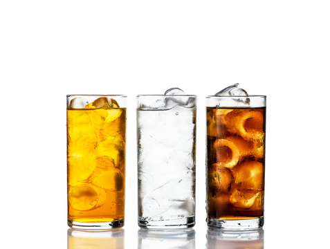three drinks with ice in a range on a white background