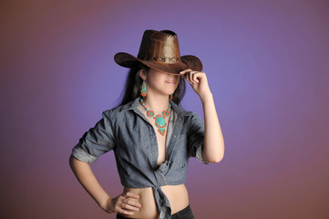 portrait of a brunette in a cowboy hat