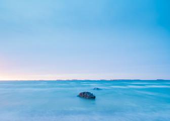 Blue sea around sunset time