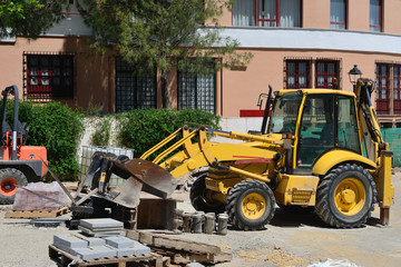 yellow tractor on the construction site