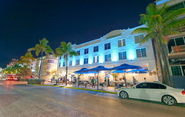 MIAMI - FEBRUARY 25, 2016: Tourists along Ocean Drive on a beautiful winter night. Miami Beach is a famous tourist attraction