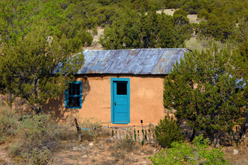 Adobe with Tin Roof and Colorful Door