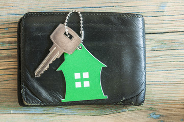 key on wallet on wooden table