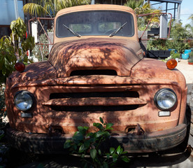 Front view of rusty vintage truck.