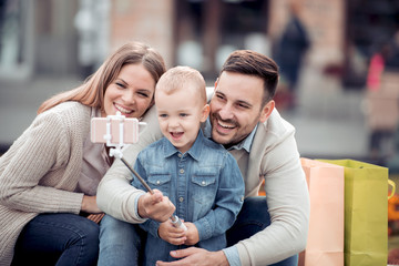 Happy family having fun together,taking selfie.
