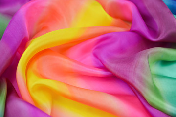 The texture is satin , silk fabric multicolor color for the background