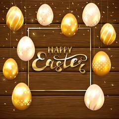 Set of golden Easter eggs on brown wooden background