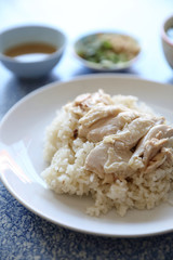 Hainanese chicken rice with cucumber in closeup , Thai food