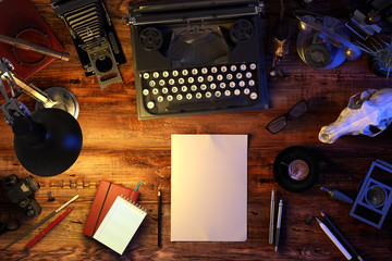 Writer's desk table with typewriter, old phone, vintage camera, skull, supplies, cup of coffee. Top view. 3D illustration