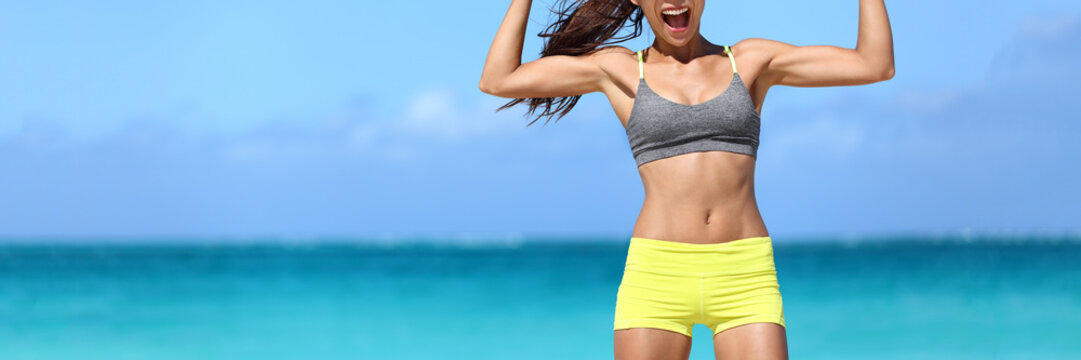 Strong fitness woman banner crop with copyspace on sky. Body crop of athlete showing off slim body on beach. Weight loss success concept.