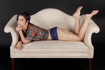 Cute Smiling Woman in Panties Lying on Couch