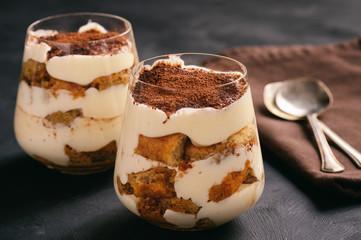 Homemade tiramisu cake in glasses, italian dessert.