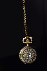Ornamented Vintage Pocket Watch on Black Background