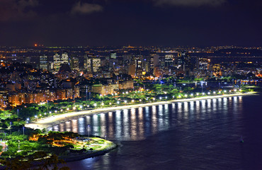 Night view of the top of the Rio de Janeiro downtown with city lights, buildings, beach and streets on a summer night