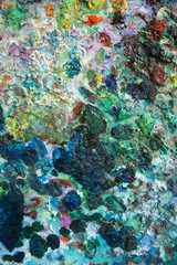 textural multicolored palette of a background of paints made by a brush