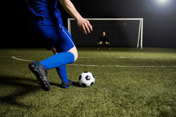 Soccer player making a kick towards the goal
