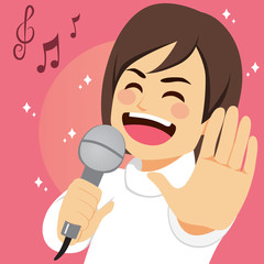 Happy young man singing song passionately with microphone