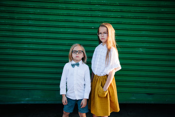 Portrait of stylish, fashionable boy and girl looking directly and fiercely into lens Wall mural