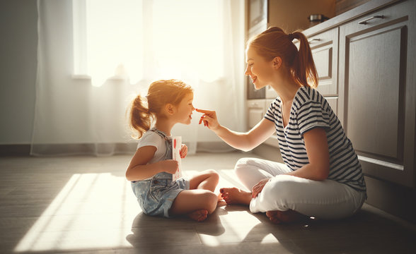 happy mother's day! child daughter congratulates her mother and  read postcard.