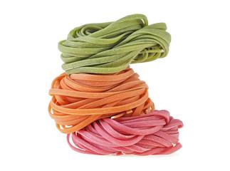 Colorful pasta tagliatelle on a white background
