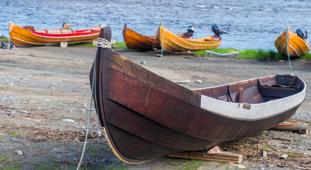 Wooden boats on the bank of river, Finnmark, Norway
