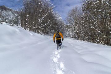A man walking on a snowy mountain