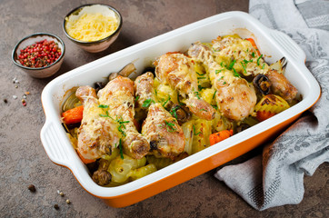Chicken legs with potatoes, mushrooms, onions and carrots