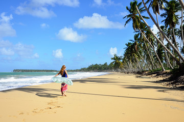Relaxing tourist on the empty, long Limon beach on Dominican Republic