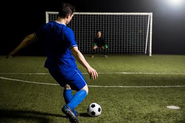 Footballer shooting a penalty kick