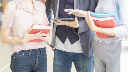 close up of group of people hold book stationary and tablet device