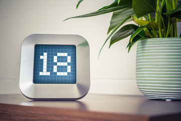 The Number 18 On A Digital Calendar, Thermostat Or Timer
