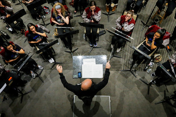 Stoneman Douglas Band Director Alexander Kaminsky is seen during a band rehearsal in New York
