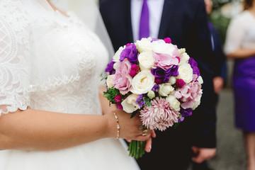 wedding bouquet in purple tones