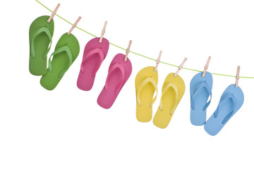 Flip flop sandals hanging from a clothes line isolated on white