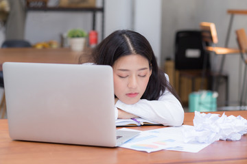 Asian woman with tired overworked and sleep, girl have resting while work writing note, business freelance concept.
