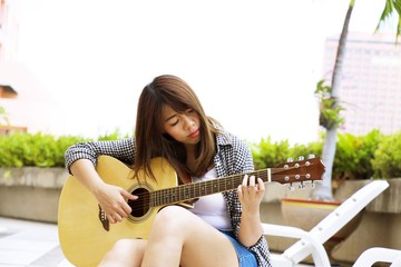 Woman is playing guitar