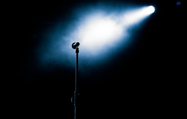 microphone in stage lights during concert - summer music festival