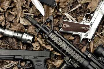 Weapons and military equipment for army, Assault rifle gun and pistol on camouflage background.