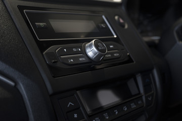 close up of modern car audio entertainment control button