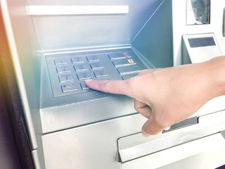 person dials the PIN code on the ATM Presentation of financial and banking concepts Finance