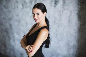 Portrait of a brunette in a black dress.