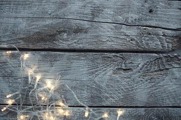 Light bulbs on light wooden background